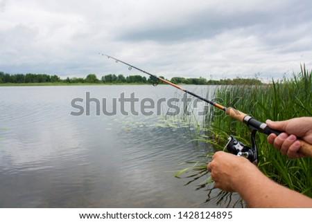 spinning fishing on the lake at dusk, fishing rod #1428124895