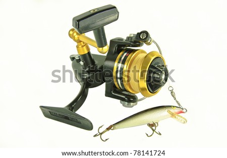 Spinning Reel:  A well-used spin casting reel is rigged with an artificial minnow.
