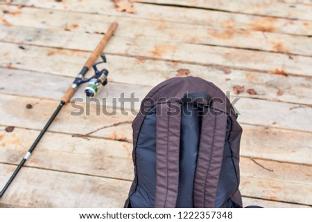 spinning rod and bag on a wooden pier #1222357348