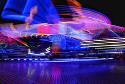 Spinning tower at a funfair in motion blur