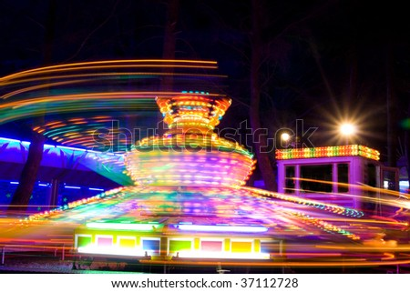 Spinning twister showing light traces at night. Motion blur.