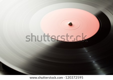 Spinning vinyl record. Motion blur image.