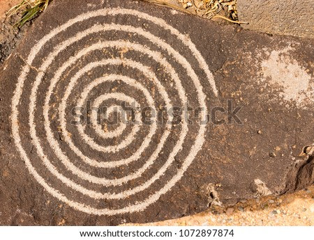 Spiral circle of life petroglyph. Ancient Pueblo etching located at Petroglyph National Monument, Albuquerque, New Mexico. #1072897874