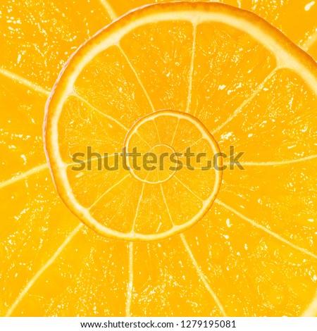 Spiral fractal mandarin orange fruit. Top view of textured ripe slice of mandarin orange citrus fruit with spiral endless skin. Endless juicy orange citrus fruit. Sea of juice concept. #1279195081