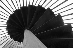 Spiral helix metal outdoor staircase black and white art shot
