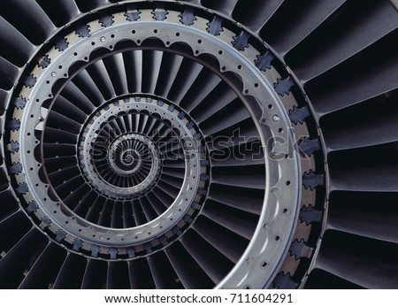 Spiral industrial production metallic turbine background. Turbine blades wings spiral effect abstract fractal pattern background. Turbine manufacturing technology abstract fractal pattern stair case