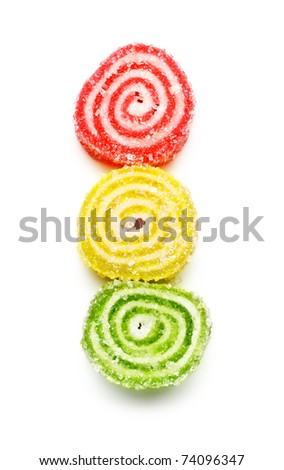 spiral marmalade sweets like traffic light isolated on white