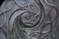 spiral metal pattern. old bronze. bronze texture background.
