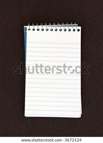 Spiral Note Pad on Textured Background - stock photo