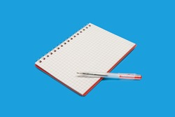 spiral notebook with a pen on a blue background
