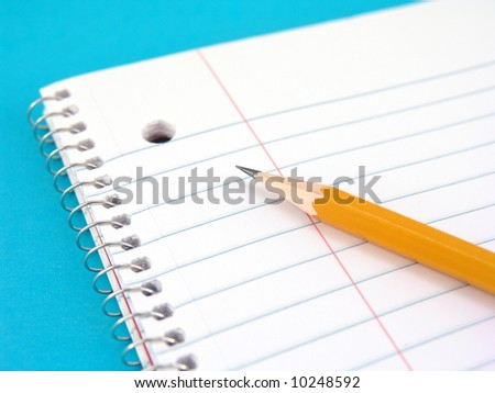 spiral notebook with pencil