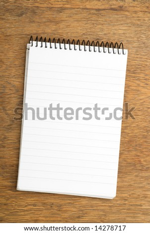 Spiral Notepad on wooden table
