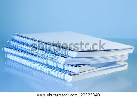 Spiral notepads on a pile - Blue filter