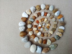 spiral of round colored beach pebbles