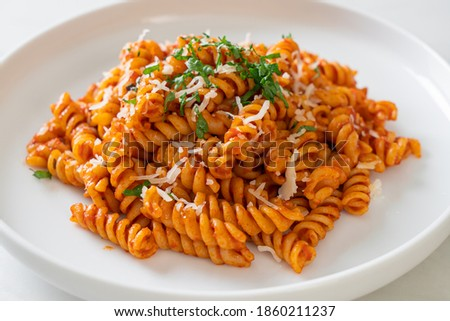 spiral or spirali pasta with tomato sauce and cheese - Italian food style Foto d'archivio ©