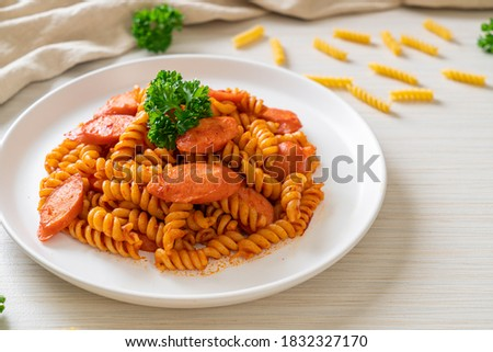 spiral or spirali pasta with tomato sauce and sausage - Italian food style Foto d'archivio ©