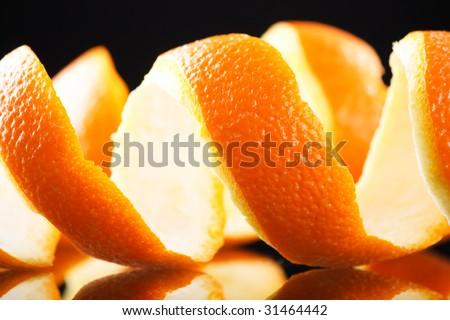 Spiral orange peel reflecting on black background