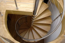 Spiral stair from house interior