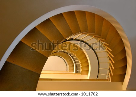 Spiral staircase in a building with beautiful, warm lighting