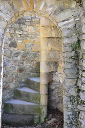 Spiral staircase in the interior of an old castle