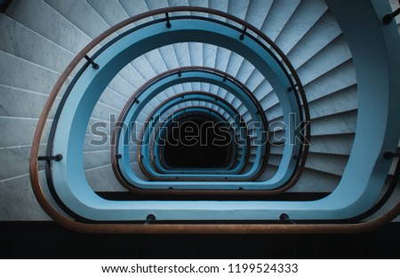 spiral staircase into infinity. Teal and orange.