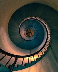 Spiral staircase of an old lighthouse. conceptual image of ascension, profitability, leading, success. Fine art.