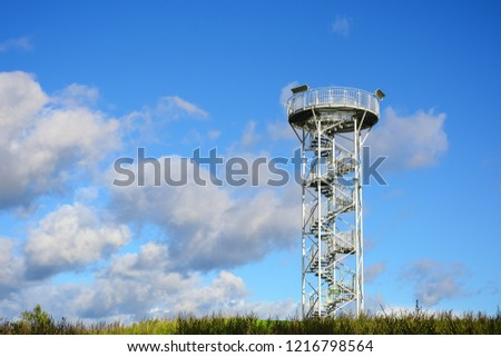 Spiral staircase of lookout tower, construction with metal steps. Observation tower, post or point, place from which to keep watch or view landscape.