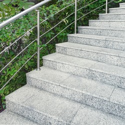 Spiral Staircase. Winding Staircase. Spiral Stairs With Stainless Steel Railing Or Handrail. Outdoor Circular Staircase In Garden Or Park. Outside Spiral Stairs With Marble Stone Steps.