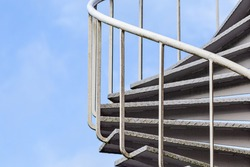 Spiral staircase with metal railing outside a building