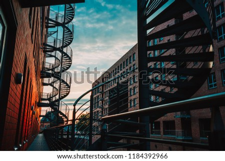 Spiral Staircases In The Old Warehouse District Narrow Canal And Red Brick  Buildings Of.