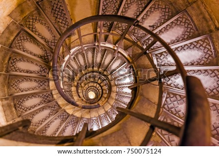 Spiral stairs inside Arc de triomphe in Paris France - travel and architecture background
