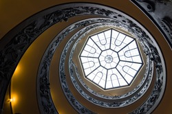 Spiral stairs of the Vatican Museums, designed by Giuseppe Momo in 1932. View from the bottom to up. Vatican City, Rome, Italy.