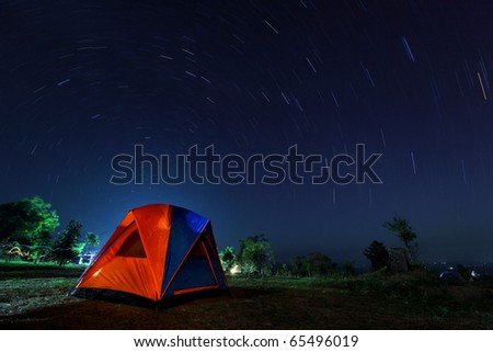 Spiral star trail with colorful tent