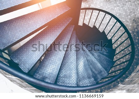 Spiral steel staircase circular staircase decoration interior. travel and architecture background.spiral staircase dark color
