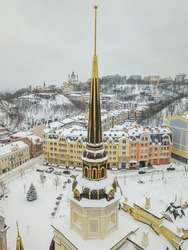 Spire on a building in Kiev. Aerial drone view. Winter snowy morning.