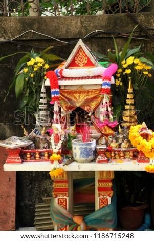 Spirit House - Spirit houses in front of family's resident. This shows that all Thai people may have spirit house as a guardian and bring good luck to the family. #1186715248
