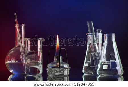 spiritlamp and test-tubes on blue-red background