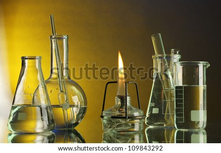 spiritlamp and test-tubes on blue-yellow background