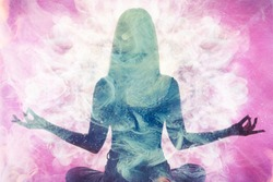 Spiritual practice. Harmony balance. Meditating woman silhouette in pink ethereal smoke double exposition.