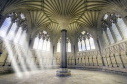 Spiritual Sun Beams Streaming Through Windows in Ornate Church Sanctuary. Chapter House in the Wells Cathedral, Somerset, UK