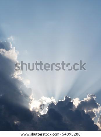 Spiritual sun rays through the clouds. Sky vertical background.
