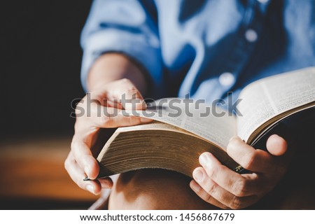 Spirituality and religion, Hands folded in prayer on a Holy Bible in church concept for faith. Stockfoto ©