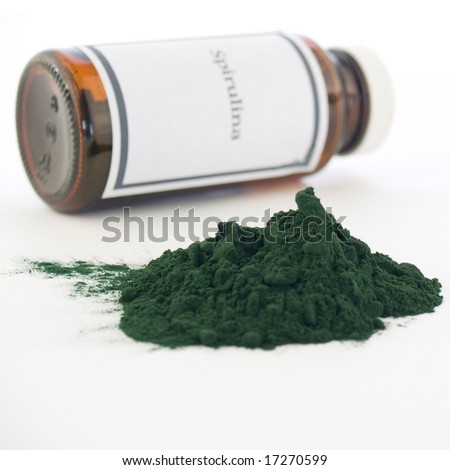 """Spirulina bottle and powder isolated on white. The generic """"Spirulina"""" label was made for the photo shoot, no infringement issues."""