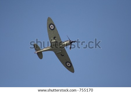 Spitfire in flight at an airshow - stock photo