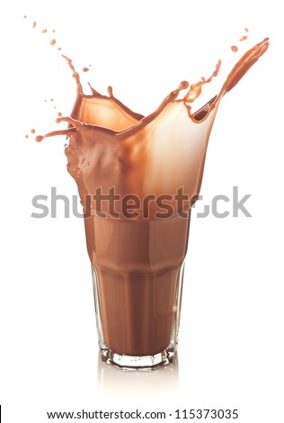 splash of chocolate in a glass isolated on white - stock photo