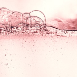Splash of cosmetic moisturizer floral water micellar toner lotion or emulsion abstract background