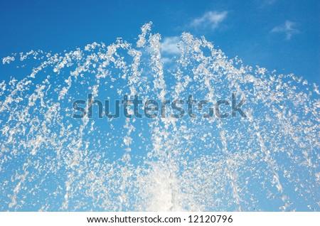 Splash of fountain in a urban park - stock photo