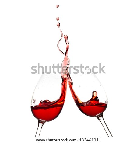 Splash of red wine in two glasses.