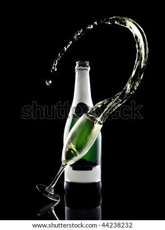 Splash of shampagne with bottle and glass