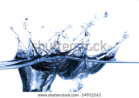 Splash of water frozen in time with a blue tint